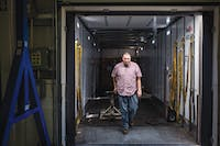 Jeremy Meece, Shipping and Receiving Specialist, works on loading a shipment of products to be sent out at Stirling Ultracold in Athens on Friday, Sept. 29, 2017. Patrick Connolly | For the Post