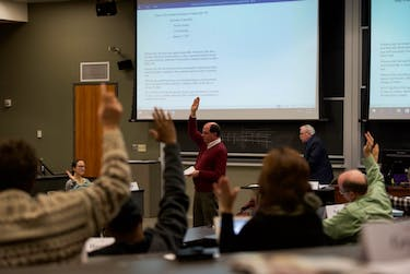 Members of Faculty Senate vote on a issue during their Jan. 9 meeting. (BLAKE NISSEN | FOR THE POST)