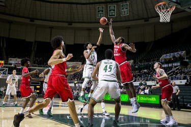 Ohio senior guard Mike Laster (#24) puts up a shot in the paint in the first half of the Bobcats' 89-84 win over Western Kentucky on Dec. 10.