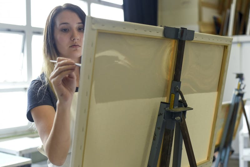 Shaylee Hoey, a sophomore studying interior architecture, paints in Andrew McNamara's Traditional Practices in Painting class in Seigfred Hall on Feb. 21.