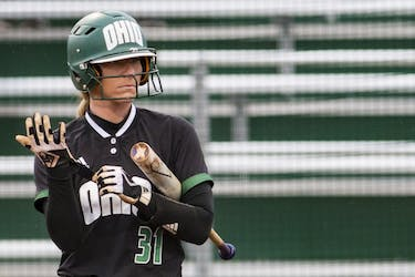 Michaela Dorsey adjusts her gloves  during Ohio's game against Pitt on March 27. The Bobcats beat The Panthers 6-1.