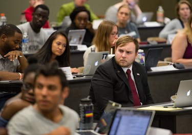 """Comissioner of Housing, Transportation & Parking Zachary Watts listens to a """"speak out"""" during Ohio University's graduate student senate's Sept. 26, 2017, meeting. (Blake Nissen 