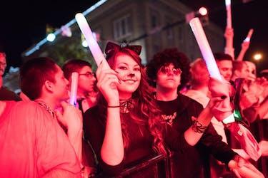 A girl listens to a concert on Court Street Saturday night MATT STARKEY|FOR THE POST
