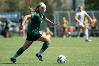 Sydney Leckie dribbles the ball down the field during Ohio's game against Central Michigan on Sunday. The Bobcats won 3-0.