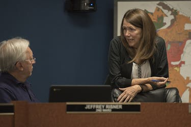 Councilman Jeff Risner, D-2nd Ward, and Clerk of Council Debra Walker chat before the Athens City Council meeting Aug. 28.  HANNAH RUHOFF | STAFF PHOTOGRAPHER