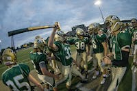 Jack Haselev (33) gets the rest of the team pumped up before their game agaist Alexander on September 15, 2017.  Athens shutout Alexander 48-0. (MATT STAKEY | PHOTO EDITOR)