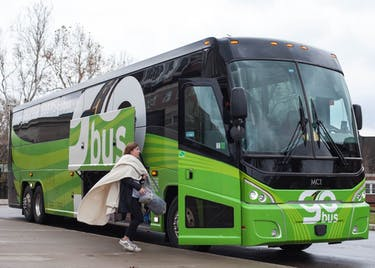 An Ohio University student barely catches the GoBus before its departure to Columbus on Sunday, November 19, 2017. (MIJANA MAZUR | FOR THE POST)