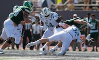 Quentin Poling strips the football during Ohio's game against EMU on Sept. 23. The Bobcats won 27-20 in overtime. (FILE)