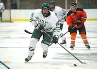 Garrett Elmore pushes up the ice during Ohio's game against Jamestown University on October 6, 2017. The Bobcats lost 3-2. (Blake Nissen   Photo Editor)