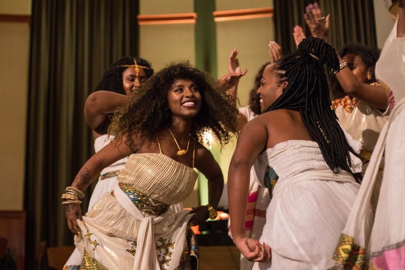 Brook Endale, Feven Berhe, Rosa Negash, Valerie Larkin, Sarah Robso and Danay Gebreal perform the Salaam dance during African Night in Walter Hall on Saturday.
