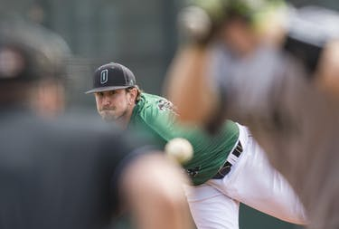 Ohio's Derek Carr pitches during Ohio's game against Eastern Michigan on April 13. The Bobcats beat the Eagles in their first game of a double header. (BLAKE NISSEN | FILE)