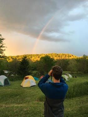 An attendee at the 2017 Birds in the Hills festival admires a rainbow. (Photo provided by Joe Brehm)