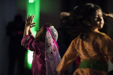 Diana Nekouei (Left) and Sara Hadizadeh (Right) dance during a performance for Yalda Night held in Walter Hall. Both girls are wearing traditional persian outfits bought by their mothers'.  (Meagan Hall | Photo Editor)