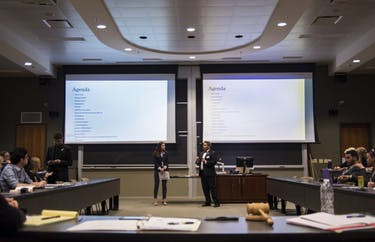 Nicole Schneider (left) and Landen Lama go over the agenda at the first Student Senate meeting of the year at Ohio University on Aug. 30, 2017. (FILE)