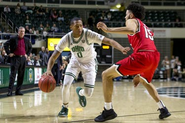 Ohio freshman guard Zach Butler (#0) drives past Western Kentucky graduate student guard Darius Thompson (#15) in the first half of the Bobcats' 89-84 win on Sunday, Dec. 10.