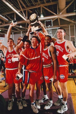 University of Wisconsin-Platteville 1994-95 team holds up the trophy after winning the National Championship.