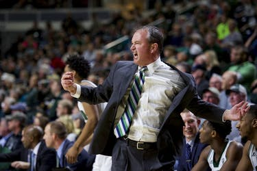 Men's Basketball Coach Saul Phillips motivating both his team and the crowd during Ohio's game against Eastern Michigan University on January 14, 2017 (BLAKE NISSEN | FILE)