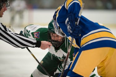 Mike Palasics waits for the puck to drop during Ohio's game against Unviersity of Pittsburg on Friday