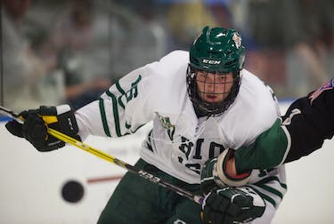 Timmy Thurnau watches the puck as it pops up during The Green v. White Scrimmage on Sept. 15. (FILE)