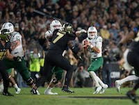 Nathan Rourke looks for an open reciever during Ohio University's game against Purdue University on September 9, 2017 (Blake Nissen | File)