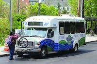An Athens Public Transit shuttle picks up passengers outside of Baker University Center on Thursday, April 30, 2015. Athens Public Transit shuttles cost $1.