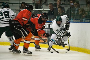 Ohio forward Cody Black makes a move for the puck during the Bobcats' game against Jamestown on Oct. 6. (FILE)