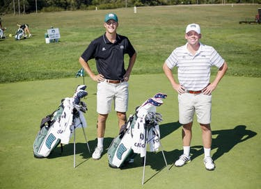 Ohio men's golf captains Peyton White, left, and Ty Herriott, right, both seniors, pose for a portrait at the Ohio University Driving Range on West State Street on Sept. 21. (FILE)