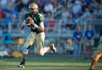 Quarterback Treyce Albin (3) rolls out to attempt a pass in the first quarter at R. Basil Rutter Field on August 26th 2016.