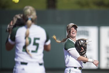 Taylor Saxton throws the ball to Mikayla Cooper after an out during Ohio's game against Buffalo on Friday, April 27. The Bobcats beat the Bulls 9-1. (FILE)