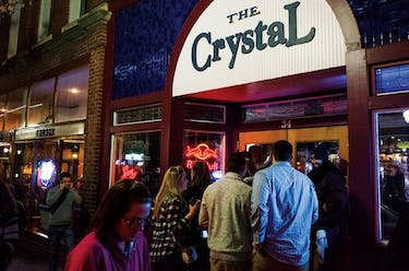 Party-goers enter the Crystal on Court Street on Feb. 6. Crowded bars often lead to bar fights, which bartenders try to resolve. When it gets too out of hand, the Athens Police Department is called.