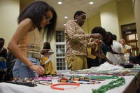 Guests look at jewelry for sale at the African Student Union's 2015 African Night Friday night in Walter Hall Rotunda. (FILE)
