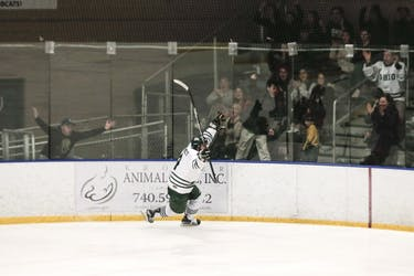 Ohio junior defenseman Tom Pokorney (#4) celebrates his breakaway goal during the third period of the Bobcats' 5-3 win over Illinois on Feb. 9 at Bird Arena. (FILE)