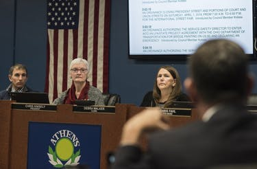 City Council members (from left to right) Peter Kotses, President Chris Knisely and Debra Walker listen to Mayor Steve Patterson at an Athens City Council meeting Tuesday. (FILE)