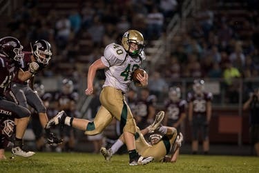 Mikel Casteel out runs his defenders during the game against Vinton County on September 22, 2017. The Bulldogs won 28-14. (Abigail Dean | For The Post)