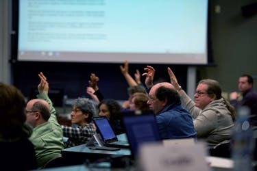 Members of Faculty Senate vote on a issue during their Jan. 9 meeting. (FILE)