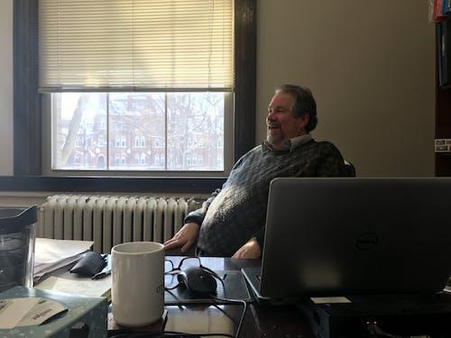 Jefferson Blackburn-Smith at his desk in the admission's office