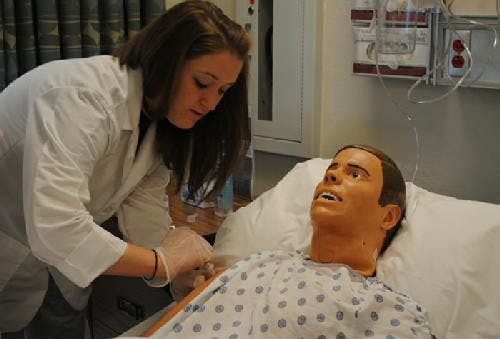 In a file photo from 2011, an Otterbein nursing student works on a manikin.
