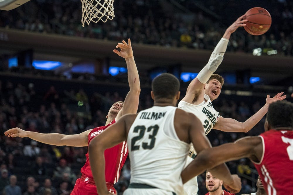 Meyer leads Iowa to win in Big Ten tourney opener