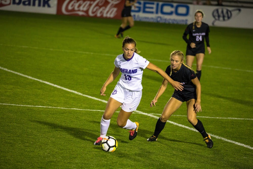 Natalie Muth handling the ball against the opponents