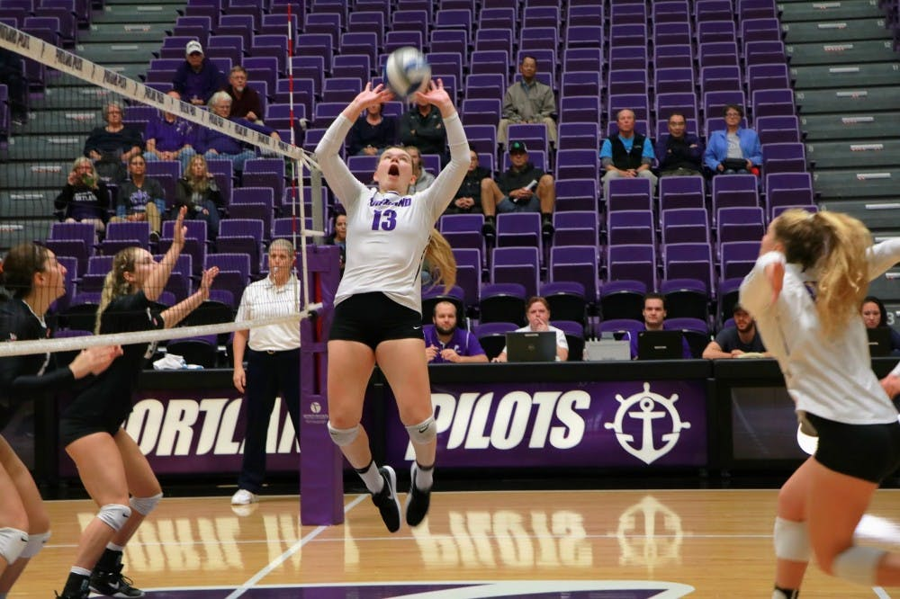 Cali Thompson sets the ball to prepare for spiker.