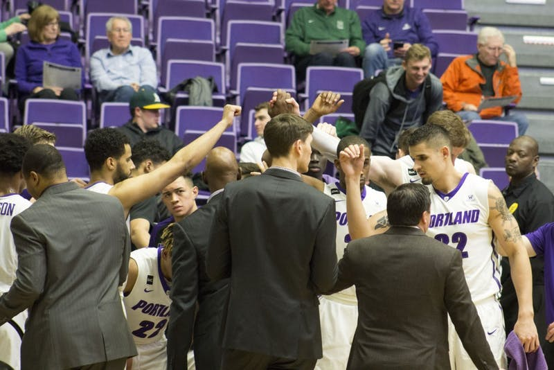 Pilots prepare to break the huddle in a conference game last year.