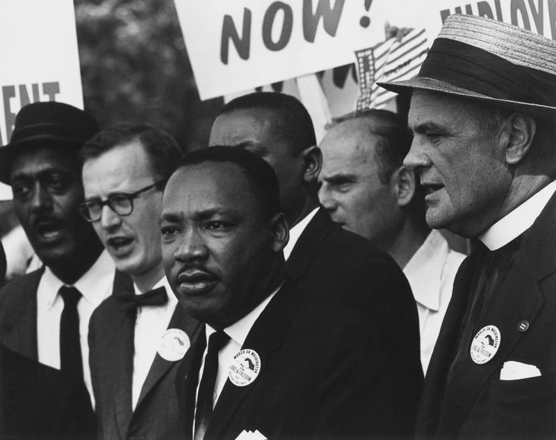 The University of Portland will begin recognizing MLK Jr. Day in 2020 by closing the university and cancelling classes. This photo is by Rowland Scherman; restored by Adam Cuerden, and is public domain via Wikimedia Commons.