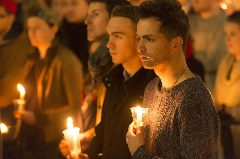 Vigil in support of the victims of the 2016 Orlando nightclub shooting, Wellington, New Zealand. Photo from Wikimedia Commons by Ola Thorsen.