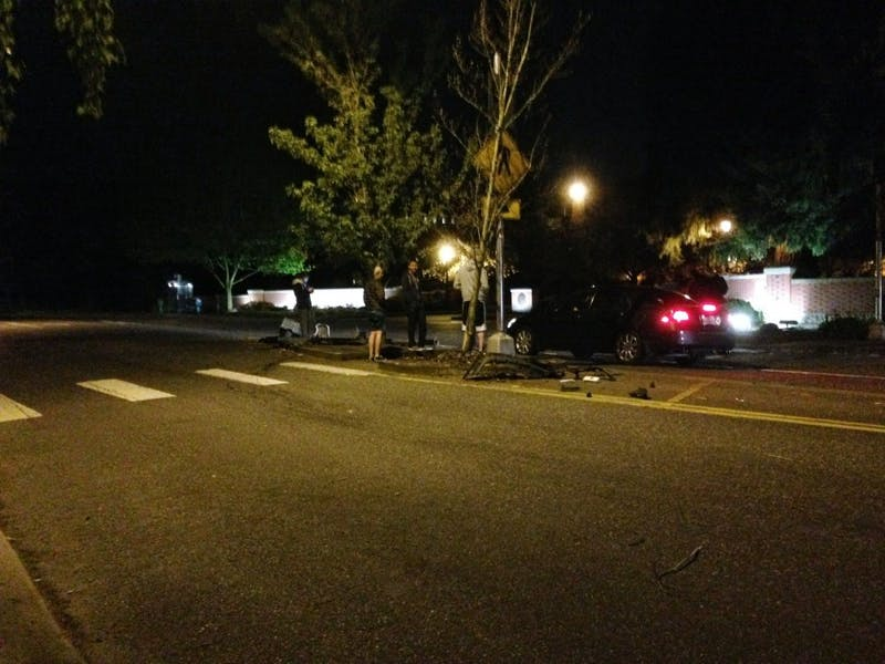 A pedestrian was struck by a vehicle on Tuesday, Nov. 21 at around 5 p.m. Photo from a 2014 collision in front of the University of Portland main entrance, where this incident also took place.