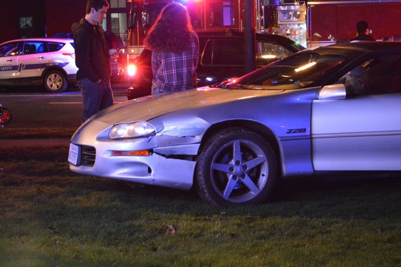 A silver Camaro hit three pedestrians in a two car collision on Friday evening around 10 p.m.