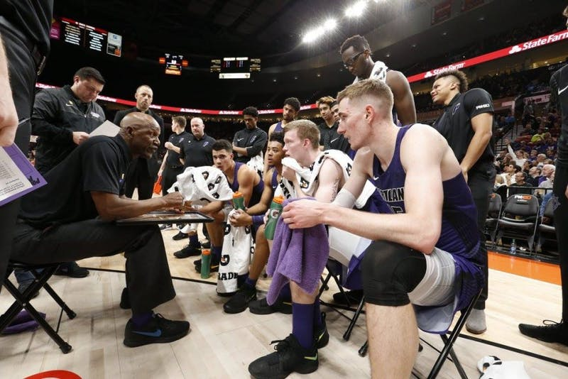 Terry Porter talks to his team during a timeout