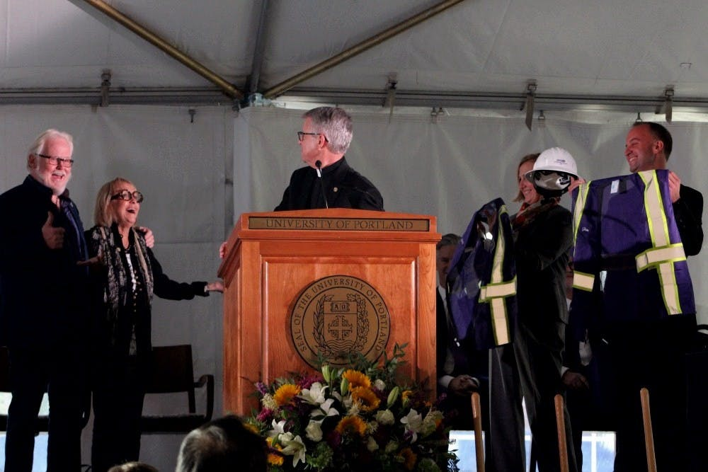 President Fr. Mark Poorman introduces leading donors Amy Dundon-Berchtold and Jim Berchtold ('63) at the Dundon-Berchtold Hall ceremonial groundbreaking Thursday evening.