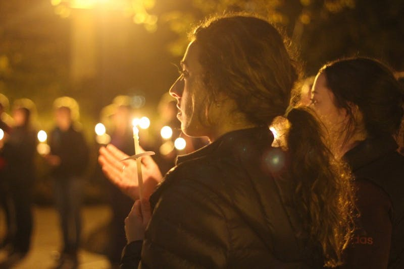 Student attends vigil last November in honor of the third anniversary of Typhoon Haiyan that devastated the Philippines.