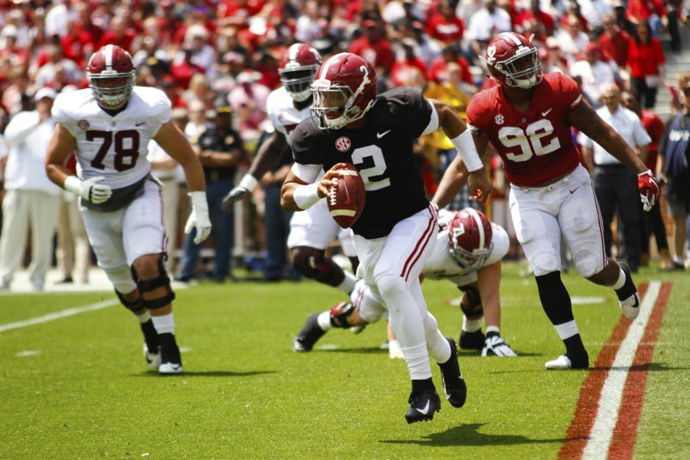 On Alabama's second day of fall camp, the quarterback questions took center stage