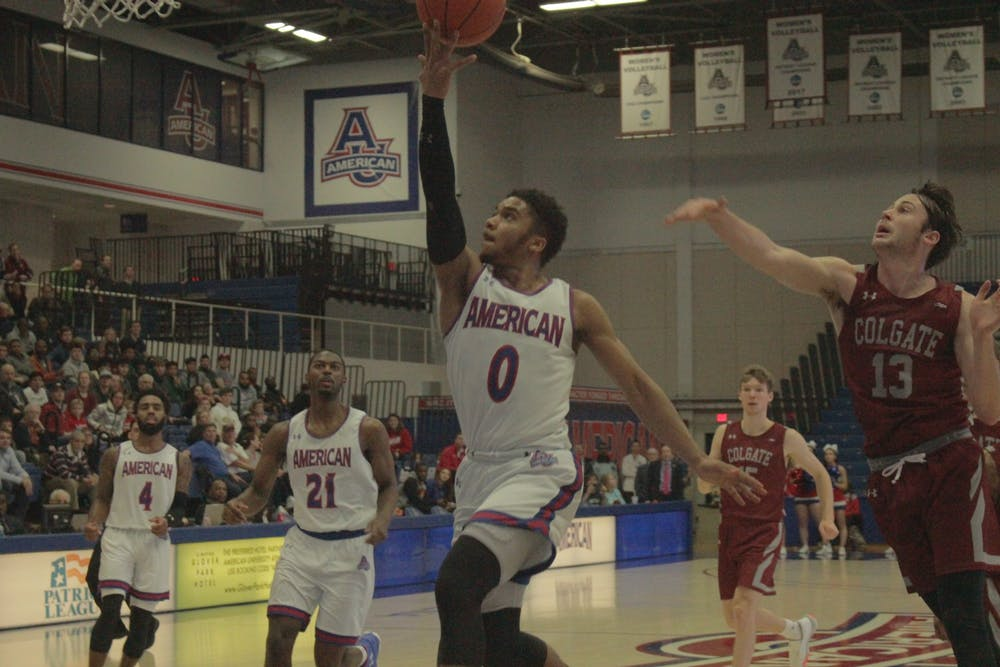 Men's basketball celebrates victory after Nelson breaks all-time record